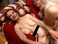 Granny takes his young cock deep in her pussy!